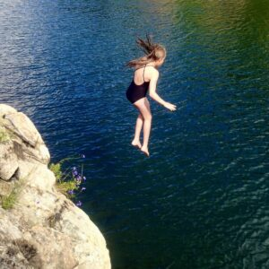 girl jumping from cliff